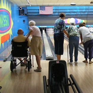 DHC Seniors and friends enjoy bowling fun.