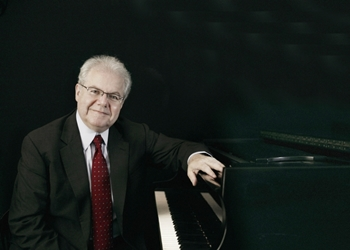 Emanuel Ax seated at the piano