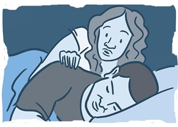 woman waking man in bed