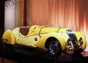 concours at amelia yellow auction car