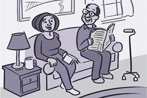older man and woman sitting on sofa